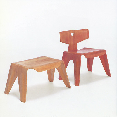 Red aniline Nested Chair alongside matching stool