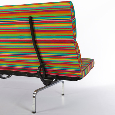 Rear side view of the Compact Sofa showing leg and feet structure