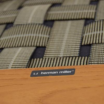 Underside of Teak Sofa showing cross fabric support and original label