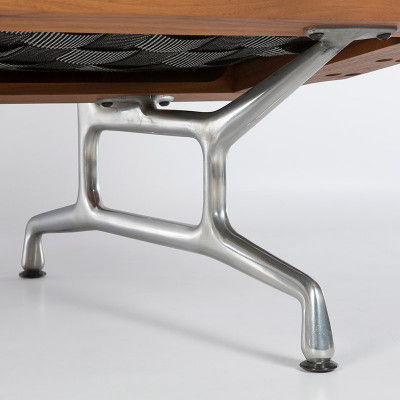 Underside image captures the cast aluminum legs and bottom cushion paneling