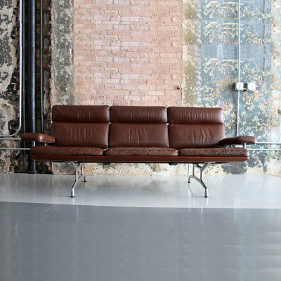 Tan leather 3 seat version of the Eames Teak Sofa