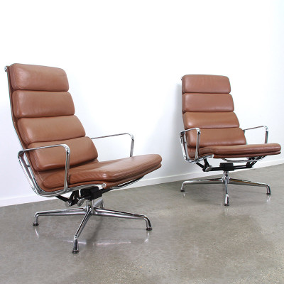 Pair of Eames Soft Pad Recliner chairs on 4 star Universal Base and in Tan leather