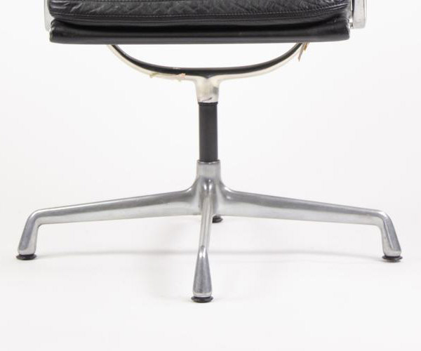 First generation 4-Star Universal Base of the Low Back Soft Pad Chair, seen with floor glides (Image courtesy of D Rose Modern)