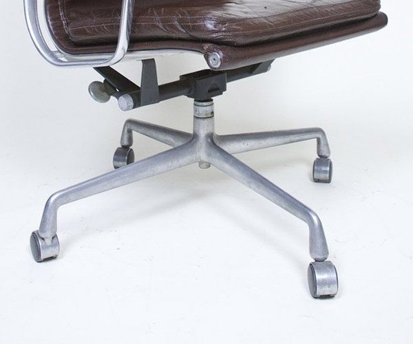 The first generation High Back Soft Pad Chair sitting on the 4-star Universal Base with castors