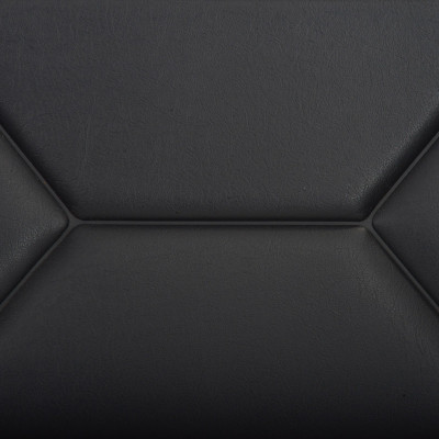Close up view of the tough Naugahyde seat and back upholstery with the distinctive heat lines