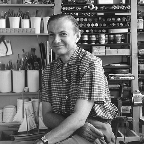 A famous portrait of Alexander Girard looking relaxed in his design studio