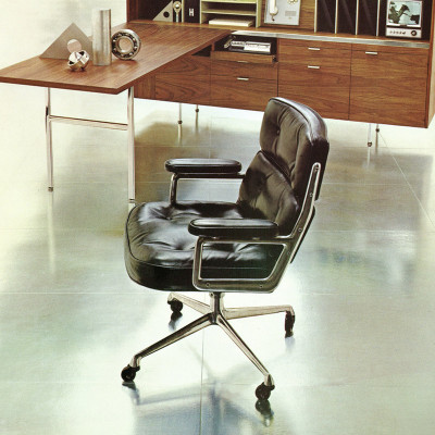 1964 Herman Miller brochure shot of the Time Life Desk chair within the Action Office