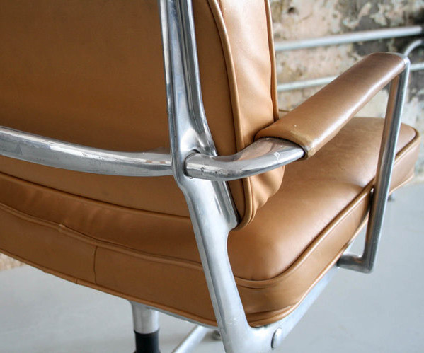 The Aluminum frame of the Intermediate Chair and a light Tan Leather seat and back