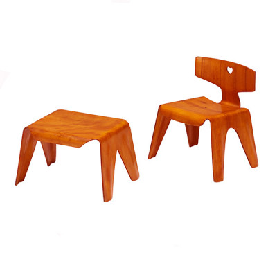 Red aniline variant of the Nested Plywood Stool alongside the matching Plywood Chair