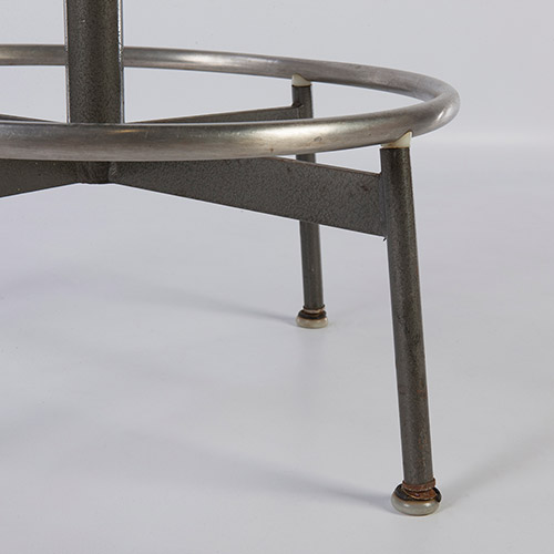 First generation of the Draftsman's Stool has the distinctive 'spider' base in grey and tall feet (image courtesy of D Rose Modern)