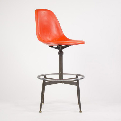 622NS Side Draftsman's Stool comprising an orange fiberglass shell and 1st generation spider base