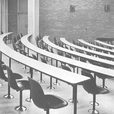 1960's Herman Miller catalog photograph of the MBP series installed into a lecture theater