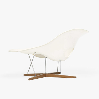 The rear view of the Eames La Chaise by Vitra with its sculptural curves and wooden frame
