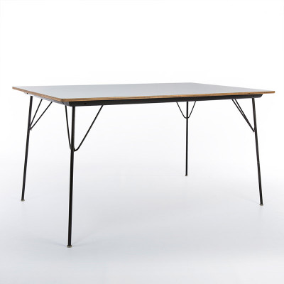 A DTM-10 rectangular drop leg table with white Micarta finish top