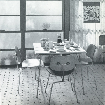 Original vintage photograph showing a DTM-1 Table and DCM chairs