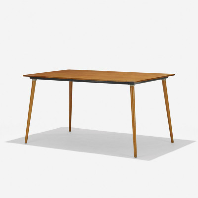 Walnut veneered top on the rectangular Eames DTW-3 dining table