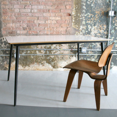 Eames DTW table with white Micarta top and black contrasting legs, shown with DCW chair