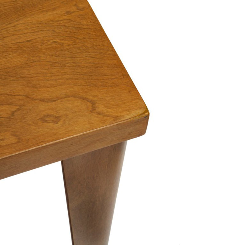 Corner section of the DTW table showing both the top and molded legs in a matching Ash veneer