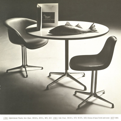 A 1964 Herman Miller catalog image show the Universal table pictured with La Fonda Side and Arm Chairs