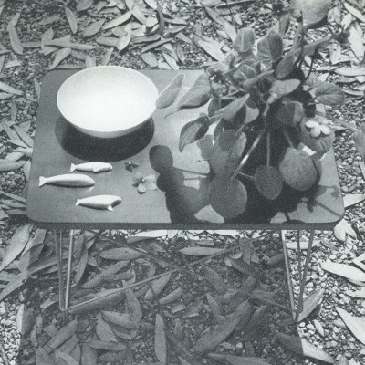 An original 1952 photograph of the LTR table demonstrating a variety of uses
