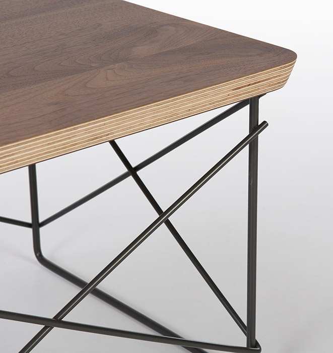 View of a modern made Eames LTR table in Walnut veneer finish, edging shows the 7 layers (each layer has a dark and light line) of ply on the newer tables. Older versions were built differently with 5 layers of ply