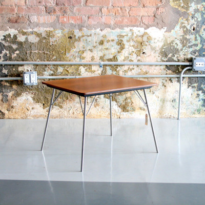 The Eames IT table shown here with a natural Walnut veneer top, fully extended