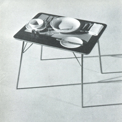 Late 1940's Herman Miller brochure page depiction of the IT drop leg table