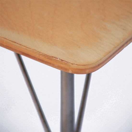 The corner of the IT side table showing the edging of the plywood layers as well as a Natural Birch top finish