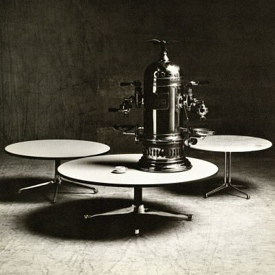 This 1964 photograph depicts the La Fonda side table (on the right) with the Universal and Contract variants