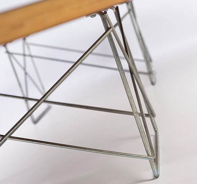 The ETR uses two of the rectangular bent rod metal base sections, as also seen on the LTR side table, which were available in Zinc or black