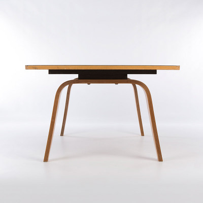 The side profile of the Eames OTW reveals the 'spacer' between the top and the bent plywood legs