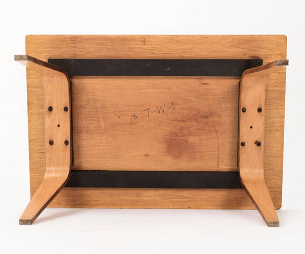 The model number CTW-1 can be seen scrawled to the underside of the table top in the center. The extra hole can also be seen in the center of the 4 wood screws that attach the plywood legs to the frame of the top.
