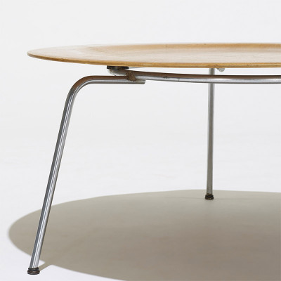 First generation profile of the Eames CTM table with the silver chrome ring section on the underside
