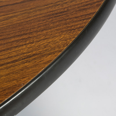 The edge of the Contract tables had a vinyl strip that was tough and durable against knocks and scrapes