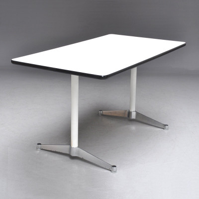 The Eames 2500 series parallel leg work and conference table shown with its original white plastic and grey vinyl edge finish