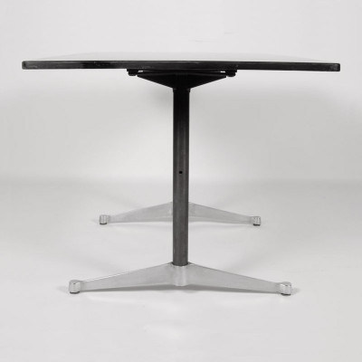 Profile side on view of the Eames 2500 series showing the polished contract style feet and black tubular columns