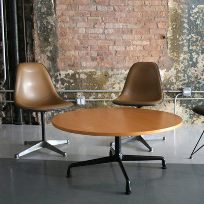 Later 1990's Eames Universal Base Coffee Table with a light Oak laminate veneer and smaller top