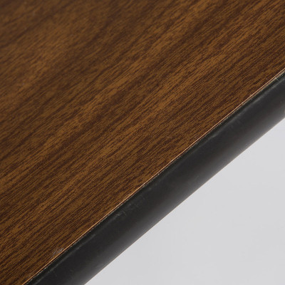 The vinyl edging of the Universal base coffee tables was designed to soak up impact from the sides