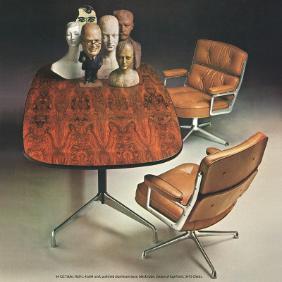 Original 1964 Herman Miller catalog image of a Rosewood Segmented conference table and time life desk chairs