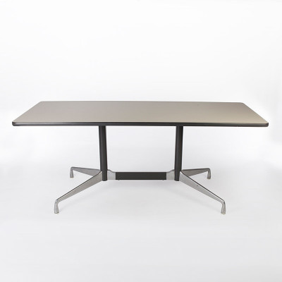 A medium sized rectangular dining work Segmented Table in the standard white laminate plastic finish