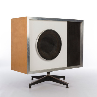 The rectangular shaped E-1S Eames Stephens Tru-sonic speaker with 'blonde' plywood housing, white micarta fascia and Saran grille, sat atop a swivel base