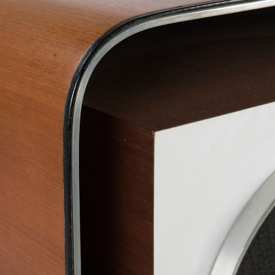 The E-4 Quadreflex speaker was designed in a square shape with beautifully curved corners on the plywood outer casing