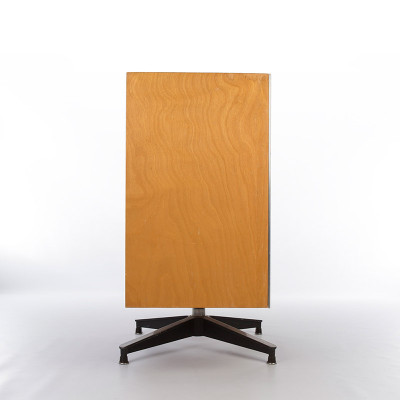 The side profile of the E-1S shows the depth of the plywood cabinet as being the same as the swivel foot base, taken from the Lounge Chair ottoman