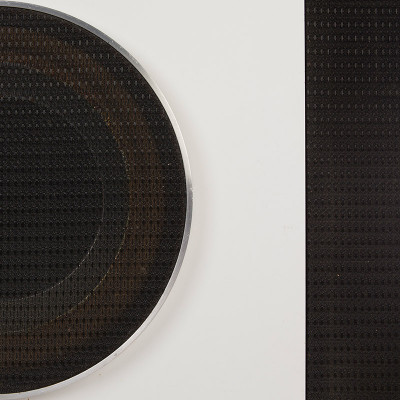 A close up of the white micarta and black Saran grille finish that adorned the E-1, E-3 and E-4 Eames speakers