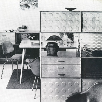 Vintage Image of the largest 400 series Eames ESU deployed as a room divider as well as useful storage unit