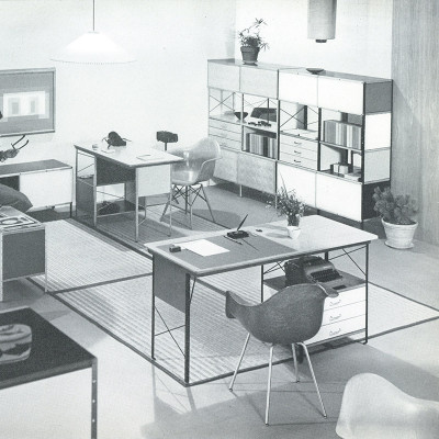 Early 1952 Herman Miller catalog image depicting the plywood ESU/EDU series with D-10 at the rear and D-20 in the foreground.