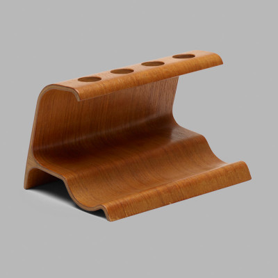 The plywood pipe stand is made from three sections of veneer and this allows the design to self-stand on any horizontal surface. The piece leans slightly to towards the part that touches the table..