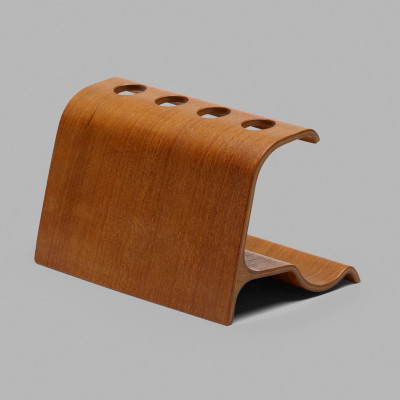 The rear of the Eames Pipe Stand shows the longer flatter side purportedly made from off cut sections of Radio Enclosures and contains the holes for the pipe stems.