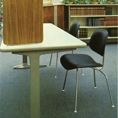 Black Eames DCMU chairs deployed in a library