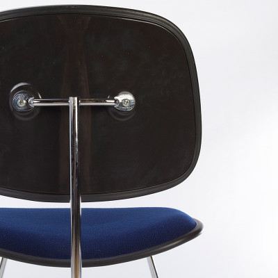 The rear of the Eames DCMU two-piece plastic chair